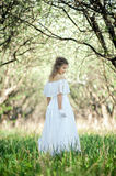 Beautiful blonde in white dress Royalty Free Stock Image