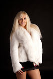 The beautiful blonde in a white fur coat Royalty Free Stock Photo