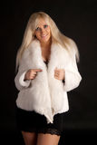The beautiful blonde in a white fur coat Stock Image