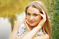 Beautiful blonde in white gown Stock Images