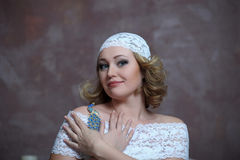 The beautiful blonde with a white lace dress royalty free stock image