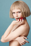Beautiful blonde wig with a red rose in her hand Stock Images