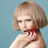 Beautiful blonde wig with a red rose in her hand Stock Photography