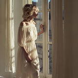 Beautiful blonde at the window Stock Photography