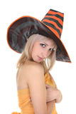 Beautiful blonde in witch hat Stock Image