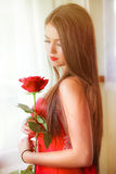 Beautiful Blonde With Red Rose Stock Photography