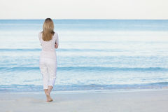 Beautiful blonde woman alone at the beach Royalty Free Stock Images