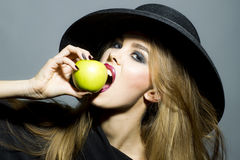 Beautiful blonde woman with apple Stock Photo