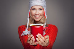 Beautiful blonde woman with an aromatic hot coffee in hands. Royalty Free Stock Photos
