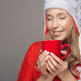 Beautiful blonde woman with an aromatic hot coffee in hands. Stock Photography