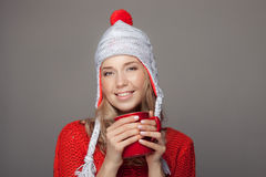 Beautiful blonde woman with an aromatic hot coffee in hands. Royalty Free Stock Image