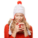 Beautiful blonde woman with an aromatic hot coffee in hands. Royalty Free Stock Photo