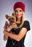 Beautiful blonde woman in autumn dress, holding a yorkshire terrier dog Royalty Free Stock Photography