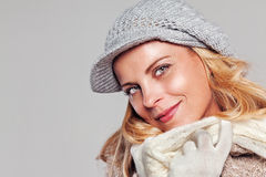 Beautiful blonde woman in autumn fashion looking to the camera Stock Image