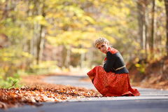 Beautiful blonde woman in autumn forest Royalty Free Stock Images