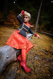Beautiful blonde woman in autumn forest Stock Images
