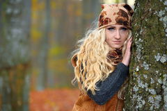 Beautiful blonde woman in autumn forest Stock Photography