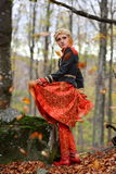 Beautiful blonde woman in autumn forest Royalty Free Stock Photo
