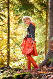 Beautiful blonde woman in autumn forest Royalty Free Stock Image