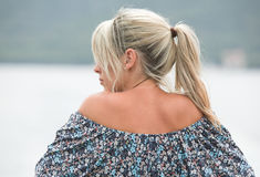 Beautiful blonde woman. Back and face from behind, outdoors. Royalty Free Stock Images