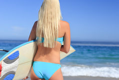 Beautiful blonde woman on the beach Royalty Free Stock Photos