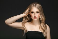Beautiful Blonde Woman Beauty Model Girl with perfect makeup over black background. Beautiful Blonde Woman Beauty Model Girl with perfect makeup and hairstyle stock photo