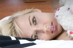 Beautiful blonde woman on bed Stock Photo