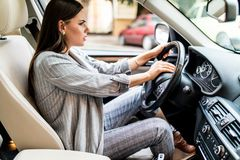 Beautiful blonde woman beep in the car in panic while driving on high speed. royalty free stock images