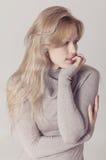 Beautiful blonde woman in beige dress Stock Image