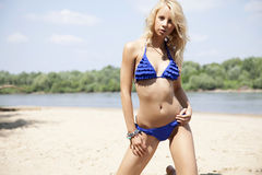 Beautiful blonde woman in bikini Stock Photography
