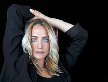 Beautiful blonde woman on black background. Royalty Free Stock Photo