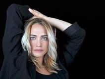 Beautiful blonde woman on black background. Royalty Free Stock Photo