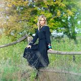 Beautiful blonde woman in black dress Royalty Free Stock Photography