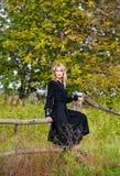 Beautiful blonde woman in black dress Stock Image