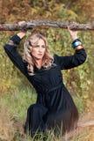 Beautiful blonde woman in black dress Stock Images