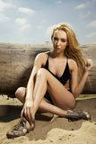 Beautiful blonde woman in black swimwear Stock Photos