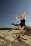 Beautiful blonde woman in black swimwear Royalty Free Stock Images