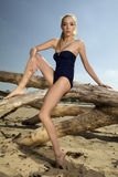 Beautiful blonde woman in black swimwear Stock Photo