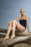 Beautiful blonde woman in black swimwear Royalty Free Stock Photos