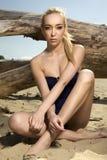 Beautiful blonde woman in black swimwear Royalty Free Stock Photos