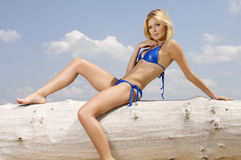 Beautiful blonde woman in blue bikini Royalty Free Stock Photo