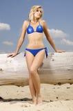 Beautiful blonde woman in blue bikini Royalty Free Stock Images