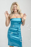 Beautiful blonde woman in a blue cocktail dress.  Stock Photo