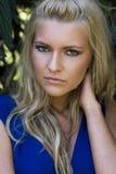 Beautiful blonde woman in blue dress Stock Image
