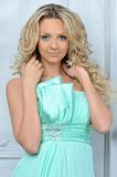 Beautiful blonde woman in a blue dress. Royalty Free Stock Images