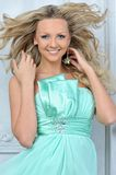 Beautiful blonde woman in a blue dress. Royalty Free Stock Photography