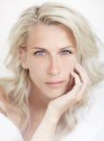 Beautiful blonde woman, blue eye, white bacground, Stock Photo