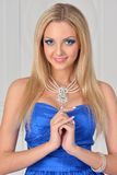Beautiful blonde woman in blue gown Stock Image