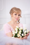 Beautiful blonde woman with a bouquet of tulips Royalty Free Stock Images