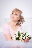 Beautiful blonde woman with a bouquet of tulips Stock Photos
